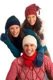Trois amis heureux de l'hiver Image stock