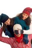 Trois amis heureux de l'hiver Images libres de droits