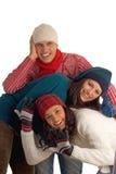 Trois amis heureux de l'hiver Photos stock