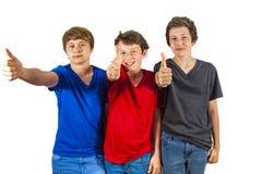 Trois amis joyeux heureux apprécient Photographie stock