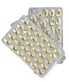 Trois ampoules des pillules jaunes Photographie stock