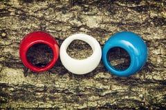 Trois anneaux colorés Photographie stock libre de droits