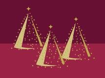 Trois arbres de Noël d'or sur le rouge Photographie stock