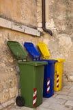 Trois bacs de recyclage colorés Photographie stock libre de droits