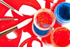 Trois balais et tubes avec la peinture Photographie stock libre de droits