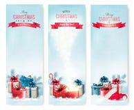 Trois bannières de Noël avec des présents Images libres de droits