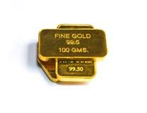 Trois barres de biscuit d'or sur un fond blanc Image stock