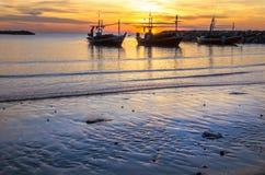 Trois bateaux sur la plage Images libres de droits
