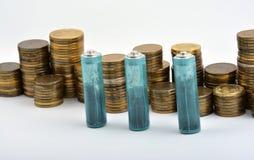 Trois batteries de D.C.A. avec des pièces de monnaie d'isolement sur le blanc Images libres de droits