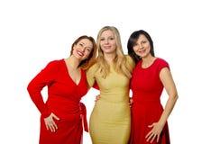 Trois belles amies dans des robes élégantes Photo libre de droits