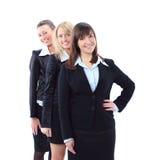 trois belles femmes d'affaires d'isolement Photographie stock libre de droits