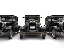 Trois belles voitures de vintage des années 1920 - la vue de face a coupé le tir illustration stock