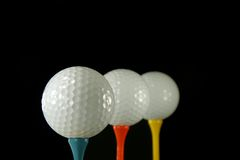 Trois billes de golf Photographie stock