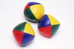 Trois billes de jonglerie colorées Photographie stock