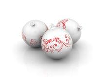 Trois billes de Noël avec des enroulements Photographie stock libre de droits
