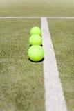Trois billes de tennis Photographie stock libre de droits