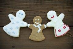 Trois biscuits heureux de femme Photo stock