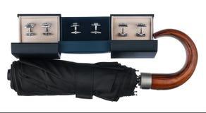 Trois boîtes avec les boutons de manchette et le parapluie Images libres de droits