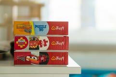 Trois boîtes de puzzle de film Photos stock