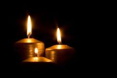 Trois bougies d'or Photographie stock libre de droits