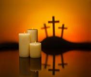 Trois bougies de croix d'espoir Photographie stock libre de droits