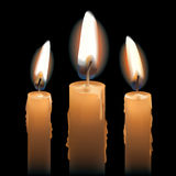 Trois bougies de Lit Photo stock