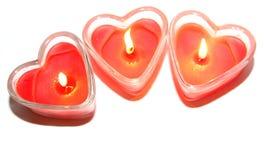 Trois bougies en forme de coeur rouges Image libre de droits