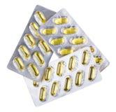 Trois boursouflures avec l'huile de poisson dans des capsules de softgel sur le blanc Photo stock