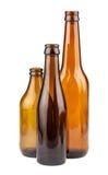 Trois bouteilles brunes vides image libre de droits