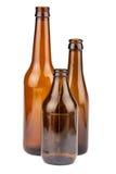 Trois bouteilles brunes vides photo libre de droits