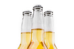 Trois bouteilles de bière d'isolement sur le blanc Photographie stock libre de droits