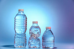 Trois bouteilles de l'eau Photographie stock libre de droits