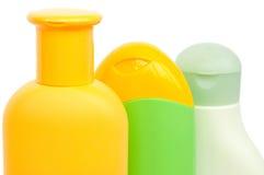 Trois bouteilles de shampooing Photo stock