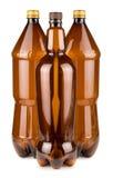 Trois bouteilles en plastique vides brunes image stock