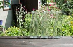 Trois bouteilles en verre vides Photographie stock libre de droits