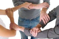 Trois bras enclenchés Photos libres de droits