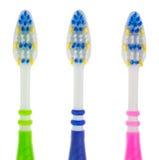Trois brosses à dents en gros plan Image libre de droits