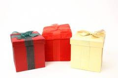 Trois cadeaux au-dessus de blanc Photographie stock