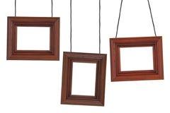 Trois cadres en bois sur les cordes Photos stock