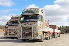Trois camions de transport de roche de Volvo Photographie stock