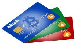 Trois cartes colorées de crédit ou de débit de bitcoin Photos libres de droits