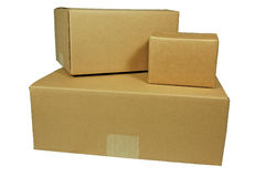 Trois cartons d'expédition ondulés (avec le chemin de découpage) Photographie stock