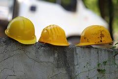 Trois casques jaunes Images libres de droits
