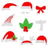 Trois chapeaux de Santa et bas rouges de Noël Photo stock