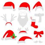 Trois chapeaux de Santa, klaxons, moustaches, barbes et bas rouges de Noël Photo libre de droits