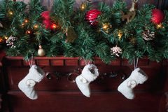 Trois chaussettes de Noël Photographie stock libre de droits