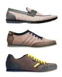 Trois chaussures d'hommes d'isolement au-dessus du blanc Photographie stock libre de droits