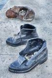 Trois chaussures sur le Danube Photographie stock libre de droits