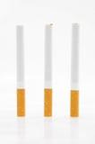 Trois cigarettes photos stock