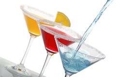 Trois cocktails colorés Photographie stock